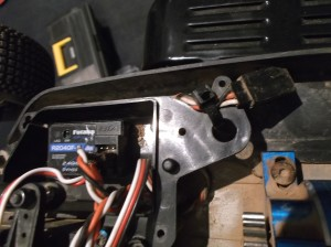 On the RC8, I anchored the end to the receiver box with a zip tie.