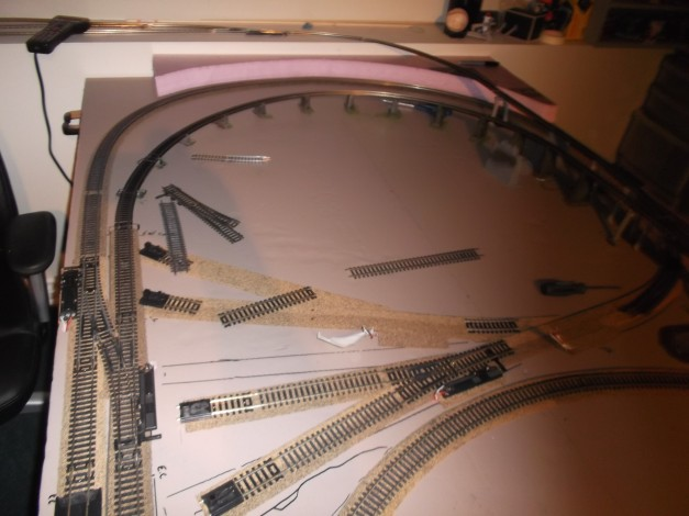 After running my trains for a week and making sure my layout worked, which it did. None the less, I decided to change it in order to add more funtion and leave more room for scenery.