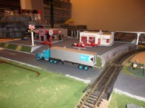 Another angle of the DQ & gas station. I went with a rock wall facing the train tracks.