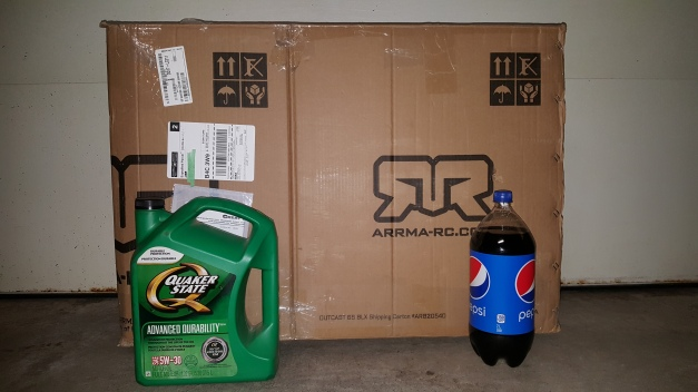 A 5L jug of oil and a 2L bottle of pop show the size of the box.